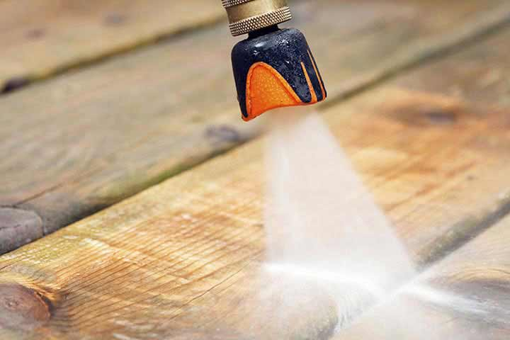 Medium pressure spray power washes deck.