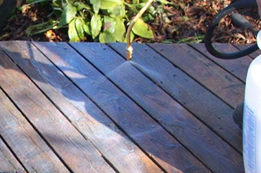 Deck being pre-soaked with an environmentally friendly cleaning solution.