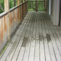 Pressure treated wood deck before cleaning.