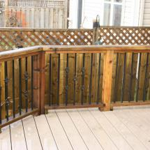 Composite deck with cedar railing after cleaning.