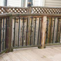 Composite deck with cedar railing before cleaning.