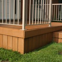Composite deck with skirting after cleaning by HD Outdoor Cleaners.