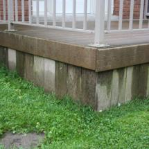 Composite deck with skirting before cleaning.