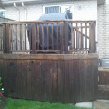Curved cedar deck before restoration.