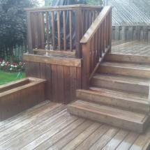 Two level deck with planter box before cleaning.