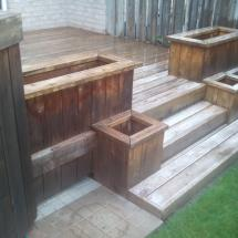 Multi-level deck with planter boxes before cleaning.