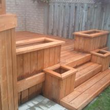Multi-level deck with planter boxes after cleaning.