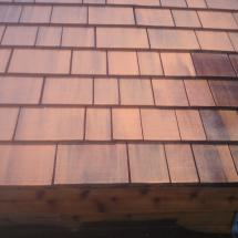 Cedar shingles on shed roof after cleaning by HD Outdoor Cleaners.
