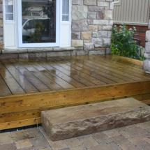 Small deck after cleaning and sealing by HD Outdoor Cleaners.