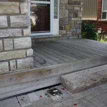 Small dirty deck before cleaning and restoration.