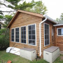 Exterior of log home after restoration by HD Outdoor Cleaners.