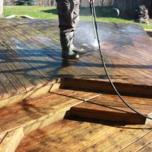 One of our team members hard at work making this old deck look new again.