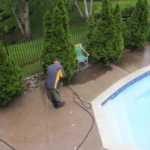 Concrete around inground pool during cleaning.