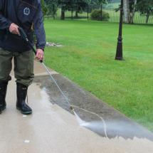 Very effective cleaning of concrete with a power washer.