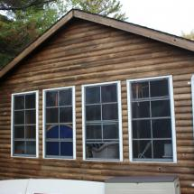 Exterior of log home before restoration.