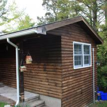 Exterior of log home before cleaning.