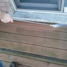 Look at the grime being power washed off this composite deck.